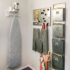 10 Ways to Organize the Laundry Room...love the gift bag holder