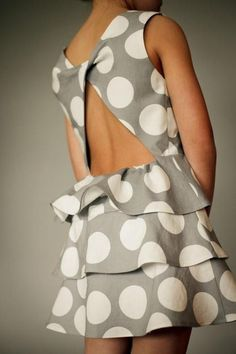 Grey and white polka-dot ruffle dress with an open back. So presh!