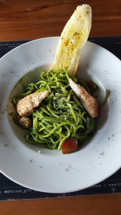 Pesto Pasta with Salmon on top. Had a really delicious meals on lunch. You can try it @Bsteak, Gading Serpong, Tangerang, Indonesia   #pasta #pesto #salmon #delicious #food #italian