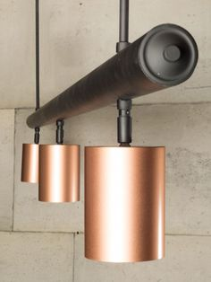 Matte black bar with three copper spotlights hanging from it, each with a inside. Black And Copper Kitchen, Gold Kitchen, Kitchen Colour Schemes, House Color Schemes, Copper Lighting, Pendant Lighting, Kitchen Room Design, Kitchen Ideas, Kitchen Sink Lighting