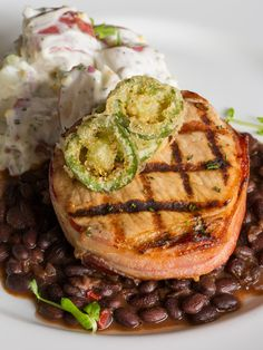 Go for a grilled specialty like the Grilled Boneless Prime #PorkChop wrapped in applewood bacon with a side of jalapeño potato salad and barbecue black beans during dinner at Glenmorgan...