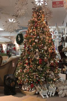 """The outdoorsman in the family will enjoy our """"Woodland"""" Christmas tree and decorations at The Bruce Company Garden Center."""