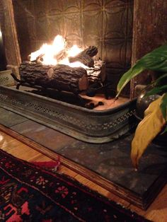Loft faux fireplace with ethanol gel logs, antique mantel and tin