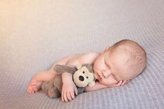 Newborn photography-- love this with Adam's old toy and my old toy in the background?