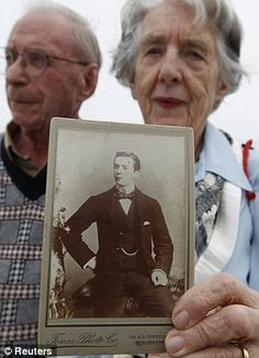 Patricia Watt with her husband David, holds a picture of her grandfather George Mackie, who died on Titanic