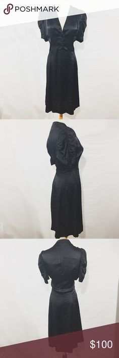 PAUL SMITH BLACK SILK DRESS W PUFF SLEEVE IT 44 M Paul Smith Blue. This dress has an effortless classic , provocative, and feminine appeal. Super thin silk. A daring neckline detailed with a star button closure. Short thick puff sleeves. Falls A line., Good condition. RETAIL $620 Paul Smith Blue  Dresses Midi