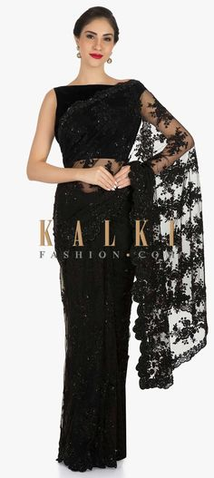 Buy Online from the link below. We ship worldwide (Free Shipping over US$100) Click Anywhere to Tag Black saree in embroidered net beautified in floral motifs with resham and moti work only on Kalki If you are a lover of black then you need not look any further but this saree in black. The saree in embroidered net is intricately constructed using resham, cord and moti embroidery work in floral motifs. The saree is teamed up with an unstitched blouse. Slight variation in color is possible.