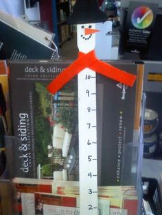 snowman snow measuring stick made out of paint stirrers from home depot