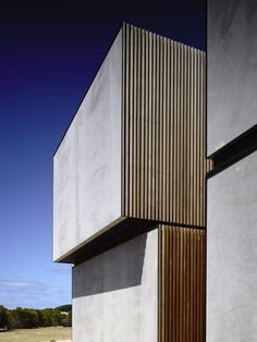 Torquay House | Woveridge Architects [off form concrete and timber batten facade]