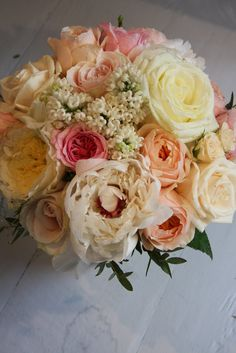 bouquet peach and cream and pink roses with peonies in blush and white flowers with spray