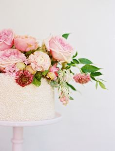 Flower topped pearl wedding cake: http://www.stylemepretty.com/collection/2127/ Photography: Ben Q. - http://benqphotography.com/