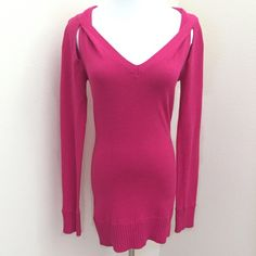 "BCBGMAXAZRIA Azalea Pink V-Neck Tunic Sweater S BCBGMAXAZRIA azalea pink v-neck tunic sweater. Size small. Worn once. Just a couple pills under the arms, which is typical for any sweater. Barely noticeable, but you can snip/shave them off, if you desire. Otherwise, flawless! Sexy cutouts at the shoulders. Longer length. Perfect w/ leggings. Very stretchy. 34% cotton, 34% rayon, 32% nylon. Approx 18"" across the bust & 29"" long from top shoulder to bottom hem. Wash cold or dry clean…"