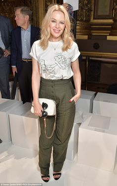 Sartorially savvy:Kylie kept things casual for the event as she arrived in a white T-shir...