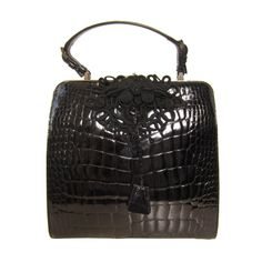 Prada Iconic and Rare Crocodile Black Bag | From a collection of rare vintage handbags and purses at http://www.1stdibs.com/fashion/accessories/handbags-purses/