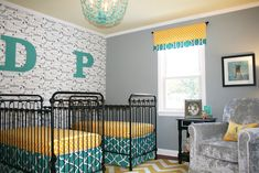 We love the accent wall and bold color choices in this nursery from @nurserydesigner!