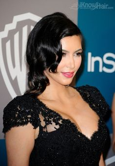 Pinned Retro Waves - Kim Kardashian has sported many Old Hollywood glamour styles throughout the years but paired with her glamorous black lace gown, her pinned-back retro waves