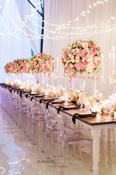 Twinkling Lights Over Pink Floral Centrepiece Table Settings