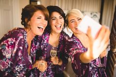 bridesmaids doing selfies at iscoyd park in floral dressing gowns