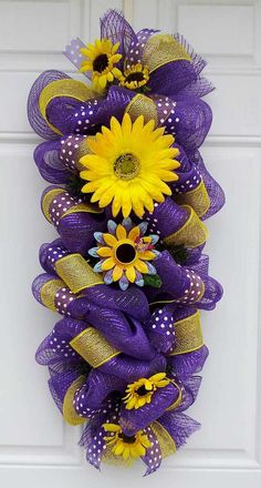 Purple Metallic Birdhouse Wall/Door Mesh Swag by This is a 31 inch Purple metallic wall/door Swag Mesh Wreath, accented with yellow mesh ribbon, purple and white sheer polka dot ribbon, a Gerber I would change out the flowers for LSU items Unavailable Lis Deco Mesh Crafts, Wreath Crafts, Diy Wreath, Wreath Ideas, Metal Wall Flowers, Flower Wall, Mesh Ribbon Wreaths, Deco Mesh Wreaths, Easter Wreaths