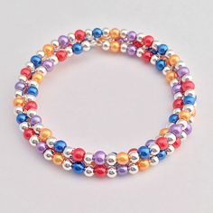 Red Blue Purple Orange Beaded Pearl Memory Wire Bracelet, Triple Wrap Around Braclet, Charm Wrapped Bracelet, Bridesmaids Jewelry by EverydayWomenJewelry on Etsy https://www.etsy.com/listing/272489998/red-blue-purple-orange-beaded-pearl