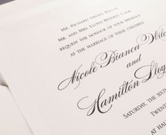 Our Pearl Stripe Border invitation is shown here in detail, engraved in black ink.