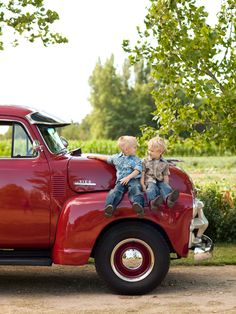 2 little cuties and a red truck...perfect. from aladysfindings.