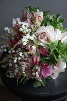 Tulip, lily of the valley, rose, astilbe and sweet peas.