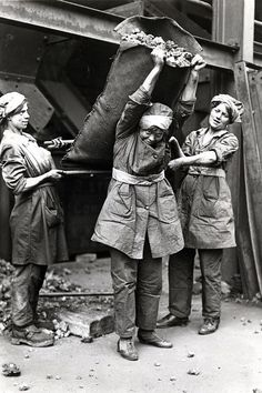 Women hauling coal possibly for a gas company. || The Most Powerful Images Of World War I