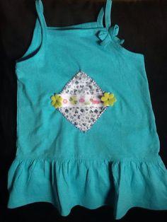 vestido de criança com aplicação em tecido
