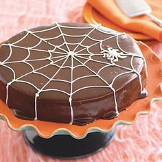 Halloween recipes: Death by Chocolate cake is a great recipe to serve for a Halloween party. Kids will love the spiderweb design on top!
