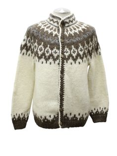 Iceland Sweaters 80's Vintage Caridgan Sweater: 80s vintage -Iceland Sweaters- Unisex natural off white base with muted brown and grey knit in pattern longsleeve Icelandic wool cardigan ski sweater. Raided neck with button front that closes with burnished gold tone buttons. Second to last button has a dent in it but it still closes properly. (made for a man but would work on a woman too)