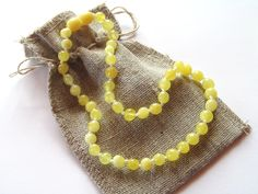 Baltic amber teething necklaces and bracelets - Butterscotch round amber teething necklace for baby, $21.99 (http://www.amber-teething-necklace-baby.com/butterscotch-round-amber-teething-necklace-for-baby/)