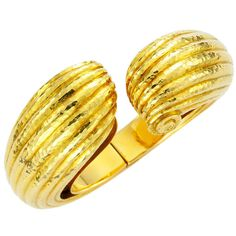 David Webb Gold Bangle | From a unique collection of vintage cuff bracelets at https://www.1stdibs.com/jewelry/bracelets/cuff-bracelets/