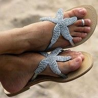 these look all sparkly and formal, I wouldn't want them for the beach, but if anyone sees something more casual with this starfish thing, lemme know... I need them for Justin's mom!