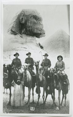 B 629060. Australian soldiers Sergeant C.B. Lewis, Private G.W. Hart, Private Howard N. Kimber, Sergeant F.C. McArtney on leave in Egypt, with the Sphinx and one of the pyramids behind them. WWI