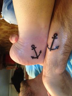 His and hers anchor tattoo.
