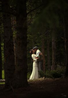 Wedding in the woods. I love the light and dark in this photo. It's eery and beautiful!