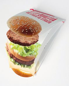 "quality matters by Francesca Scalon, via Behance    ""is a brilliant play with the perspective shoot of the burger and the placement on the brochure"""