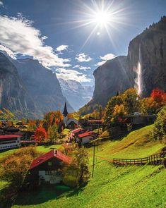 Small village in Switzerland overlooking a mountainous waterfall