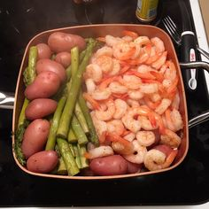 Red potatoes Fresh aspargus Frozen shrimp peeled and deveined 1 can of veg broth Use broth instead of water for steaming Thaw shrimp Steam potatoes until soft add asparagus until soften then add thawed shrimp season with cajun seasoning