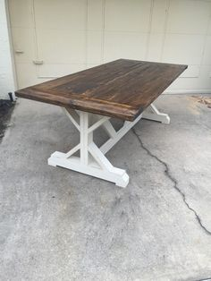 8 Foot Farmhouse Table stained in Minwax Dark Walnut with white painted legs. All of our tables are sealed with a satin or matte polyurethane. Dimensions: 96 L x 37 W x 29 3/4 H  Benches are available for $100 each.  We do custom work and offer this table in a variety of sizes and many colors. This table top also comes in planks without the breadboards on the ends. Please contact us for a quote and we can create a new listing. Our orders usually take anywhere from 6-8 weeks depending on how…