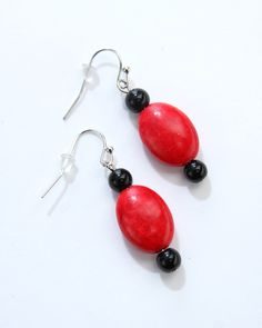 Vi Bella Jewelry - Flame Earrings - Red is making its comeback with a vengeance! Flame Earrings consist of large red oval dyed turquoise beads and small round black accent beads. Wear with the Flame Necklace and Bracelet or Flicker or Fire Necklaces.  Outstanding!     Length - 1.75 Inches      Handcrafted by Vi Bella Artists in Haiti.  $12.95