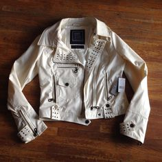 BNWT Paper Denim & Cloth Leather Jacket Such a fun edgy jacket. I bought it and never wore it. It is a medium but can fit large. Beautiful ivory color with lots of pockets and bronze studs. Vegan Leather. Free People Jackets & Coats