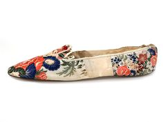 Brocaded ribbon-silk covered ladies slippers, circa 1850, of white kid overlaid in colourful silk, British, from Shoe Icons.