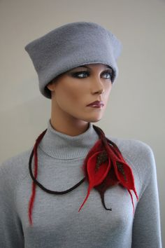 This is a special felted necklace made from merino wool,alpaca and knitted wire. You can use in a variety of ways. Is tied with laces. And you can
