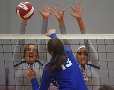 Ballard's Juliana Vier (10) and Olivia Vier (4) attempt to block a spike by Bondurant-Farrar's Abigail Wood during the second set on Thursday, Sept. 8, in Huxley. Photo by Nirmalendu Majumdar/Ames Tribune http://www.amestrib.com/sports/20160908/prep-volleyball-ballard-top-bondurant-farrar-in-five-sets