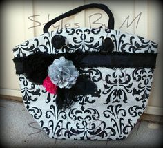 Adorable bag accented with flowers and feathers  $30