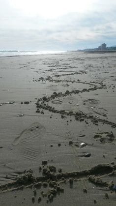 Signs on the sand! Summer is over