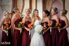 Wine, Burgundy bridesmaids dresses. Orange flowers. Wedding party. Daniel Events
