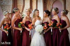 Wine, Burgundy bridesmaids dresses. Orange flowers. Wedding party. Daniel Events
